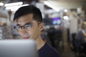 Focused engineer working at laptop