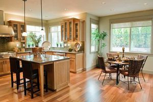 A modern kitchen with a dining table and kitchen island.