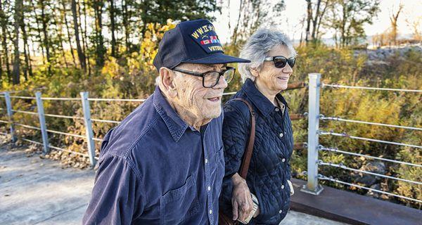 World War II U.S. military veteran father and daughter walking