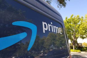 Closeup of the Amazon Prime logo on a delivery truck.