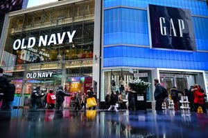 Pedestrians walk past Old Navy and GAP stores in Times Square