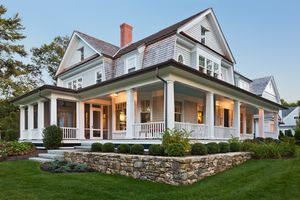 Large home with wraparound porch