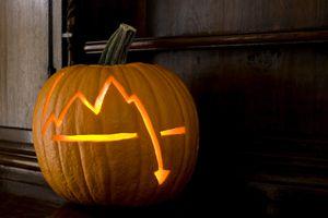Stock market crash chart on Halloween pumpkin.