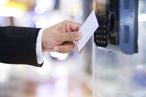Businessman scanning security card on machine