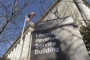 Picture of Internal Revenue Service building with blue sky and American flag