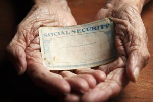 Hands holding Social Security card.