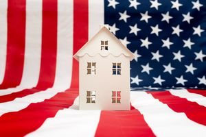 One house on American flag background.