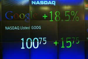Google's rising stock price appears on the NASDAQ Marketsite just before the markets close August 19, 2004 in New York.