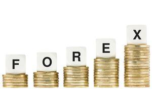 Forex spelled in letter blocks on stacks of gold coins