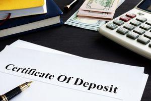 paper-saying-certificate-of-deposit-with-pen-calculator-money