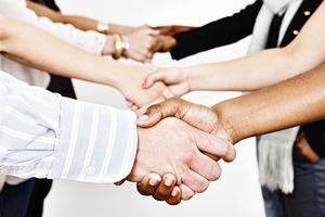 Multi-ethnic handshakes.