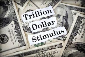 Hundred dollar bills with the words trillion dollar stimulus.