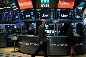 NEW YORK, NEW YORK - MAY 10: Traders work on the floor of the New York Stock Exchange (NYSE) before the Opening Bell at the NYSE as the ride-hailing company Uber makes its highly anticipated initial public offering (IPO) on May 10, 2019 in New York City. Uber will start trading on the New York Stock Exchange after raising $8.1 billion in the biggest U.S. IPO in five years.Thousands of Uber and other app based drivers protested around the country on Wednesday to demand better pay and working conditions including sick leave, overtime and a minimum wage.