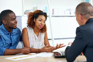 A shot of a young couple consulting a financial advisor.