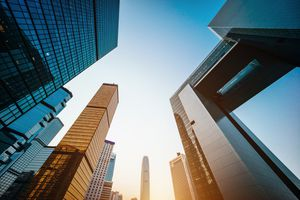 Low angle view of modern financial skyscrapers in Central Business District, Hong Kong at sunrise