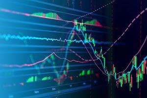 Stock market data on digital display.
