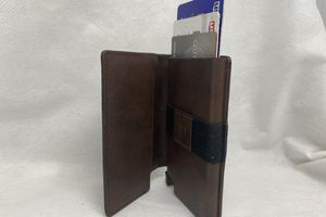 The Ekster wallet with debit and credit cards sticking out