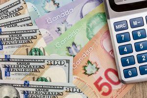 A calculator alongside US and Canadian dollars