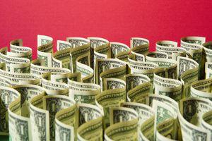 Sea of US 1 dollar bills on red.