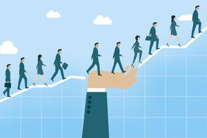 A group of business people walking up a graph with a sky in the background.