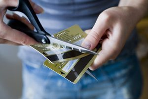 Cutting two credit cards with scissors