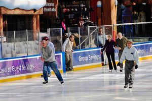 Older people ice skating at a rink