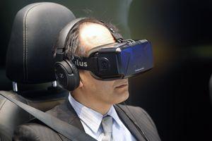 A man wears a virtual reality head-mounted 'Oculus Rift'