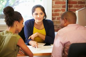 Tax preparer talks to two clients