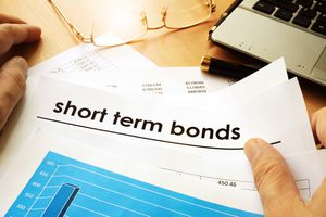 A papers with title short term bonds on the desk.