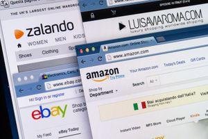 A close-up of Online shopping web sites on computer screen including Amazon, eBay, Zalando, Luisa Via Roma.