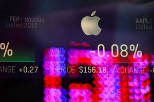 Stock numbers for Apple are displayed on a screen at the Nasdaq MarketSite in Times Square