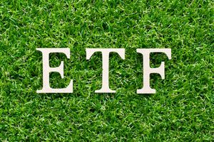The words ETF over a green hedge