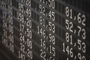 a board showing stock prices