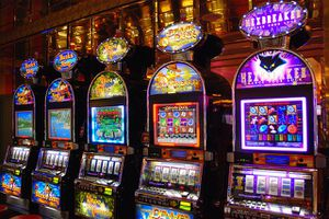 This photo shows a row of slot machines