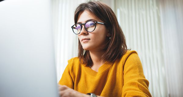 Portrait of businesswoman working on an office computer.