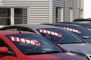 Row of pre-owned cars for sale
