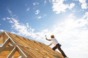 A man constructing a roof