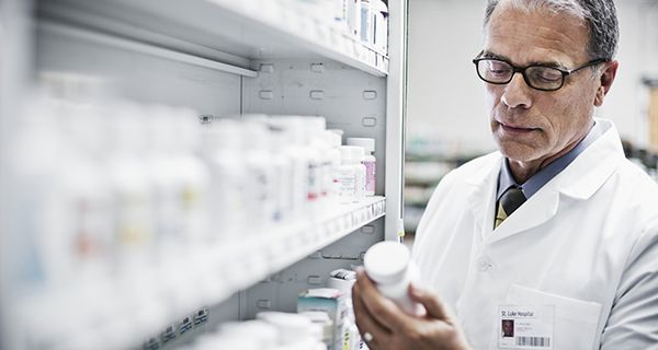 Image of worker selecting a pharmaceutical product