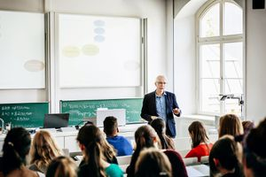 University Lecturer Addressing His Students