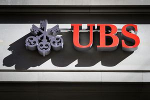 A sign of Swiss banking giant UBS is seen on a branch in Bern