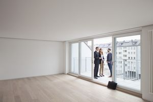 A young couple viewing flat with estate agent.