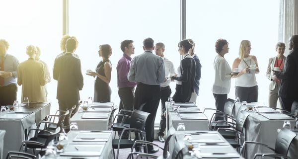 Group of professional people talking in a conference room.