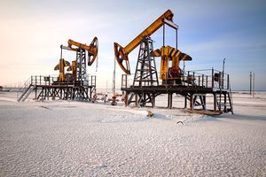 Oil rigs and snow-covered landscape