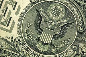 "Close-up of the eagle and ""E Pluribus Unum"" on a $1 bill"