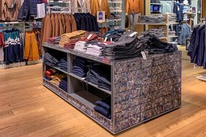 Clothing displays in a retail store for casual menswear.