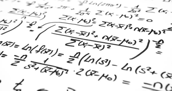 A series of math equations written in marker