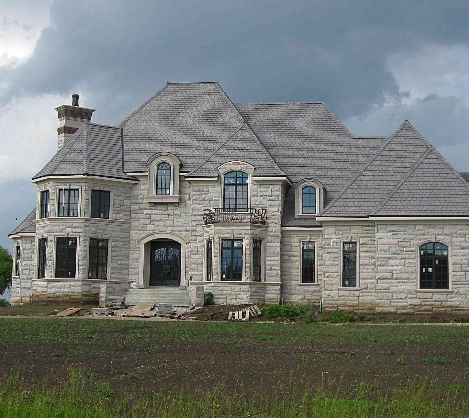 Large grey stone mansion too big, so it's called a McMansion, in Illinois