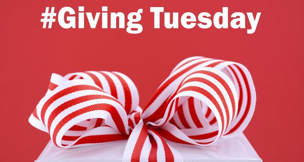 """Picture of white package with red-and-white-striped ribbon and label """"#Giving Tuesday"""""""