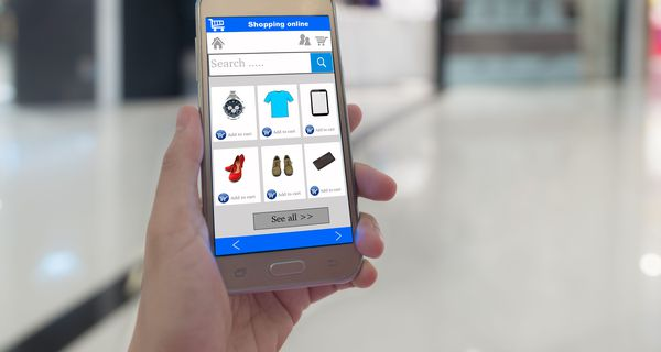 Picture of smartphone with basic shopping items presented