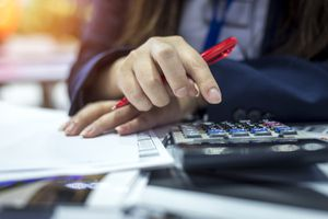 An accountant using a calculator.